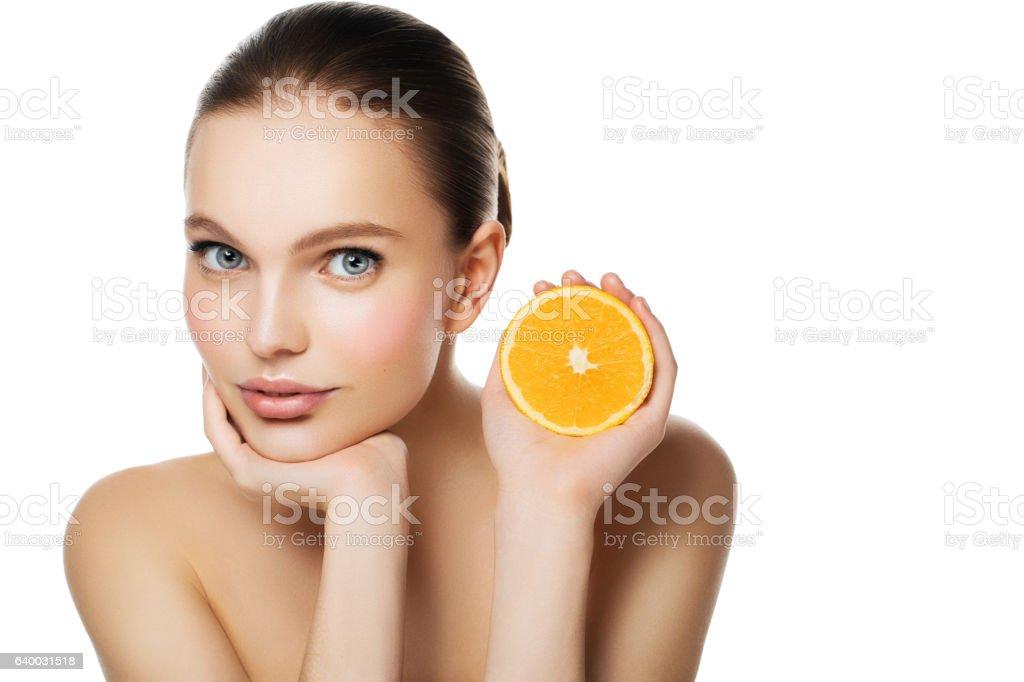 Woman holding halved orange stock photo