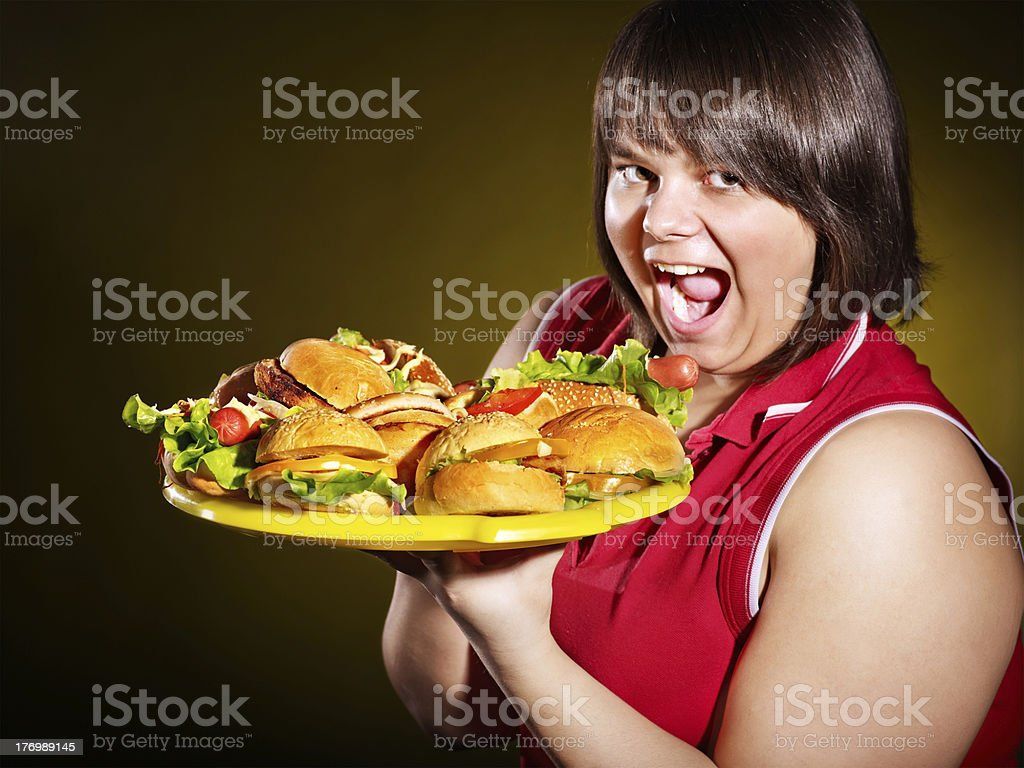 Woman holding hamburger. royalty-free stock photo