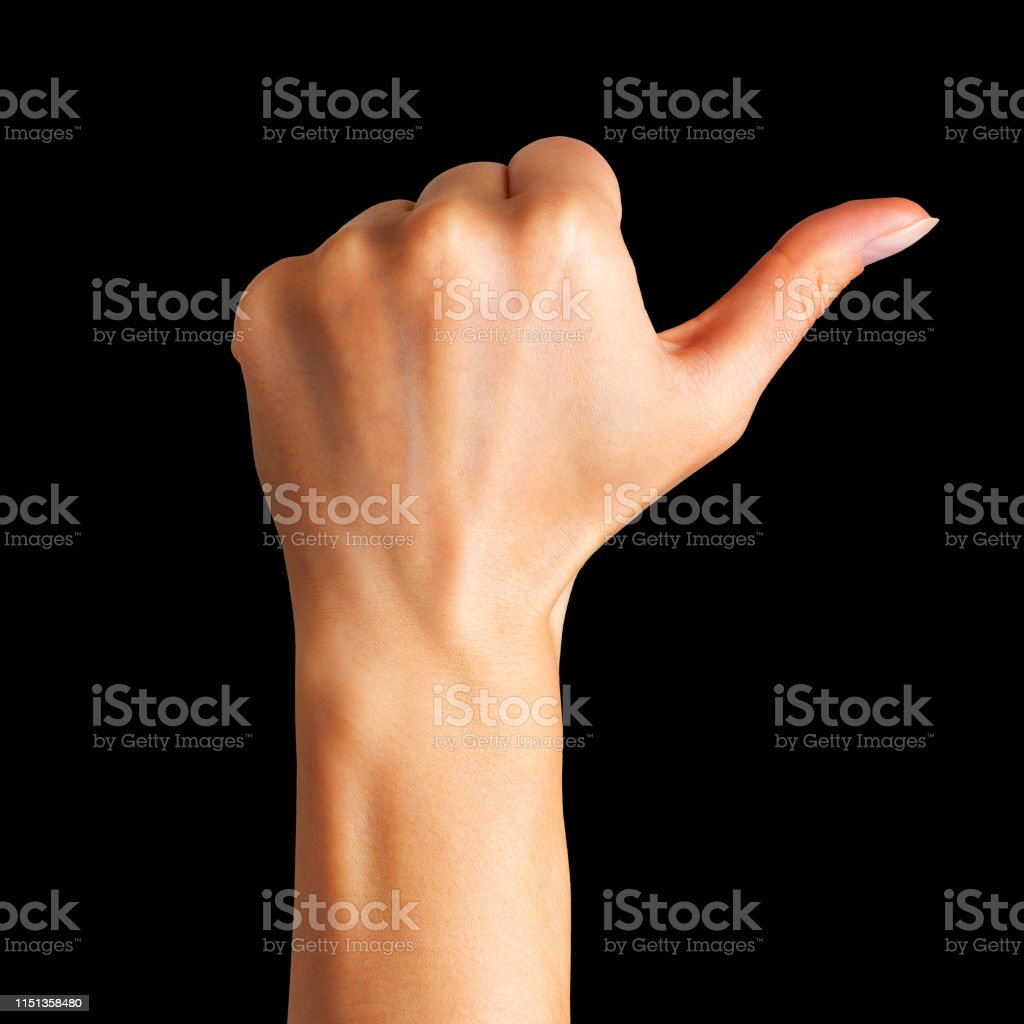 Woman holding hand in gesture of like sign, giving thumb up on black...