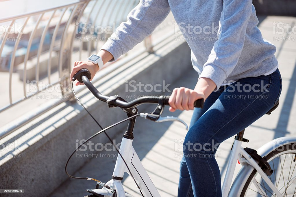 Woman holding handles on bicycle royalty-free stock photo