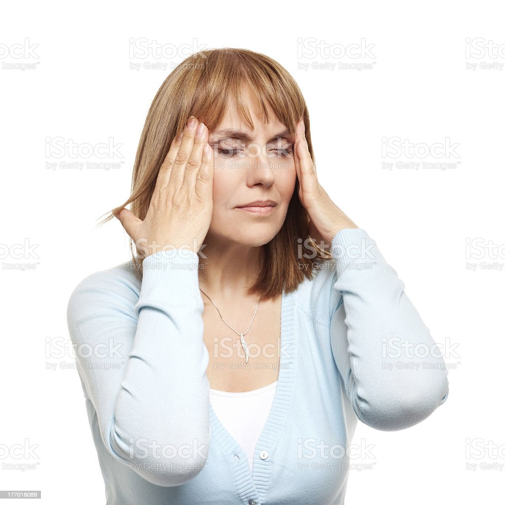Woman holding hands to her head in pain royalty-free stock photo