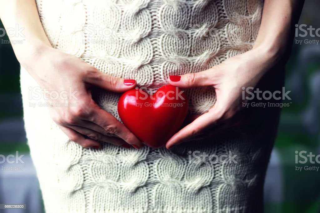 Woman holding heart stock photo