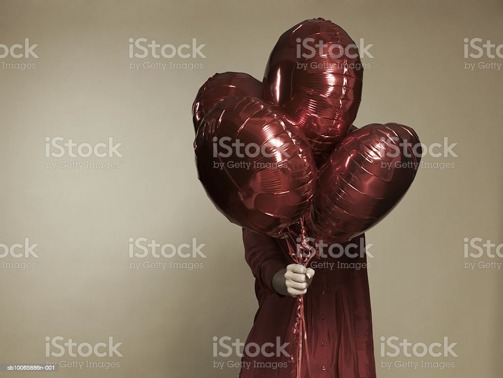 Woman holding heart shape balloons royalty-free 스톡 사진