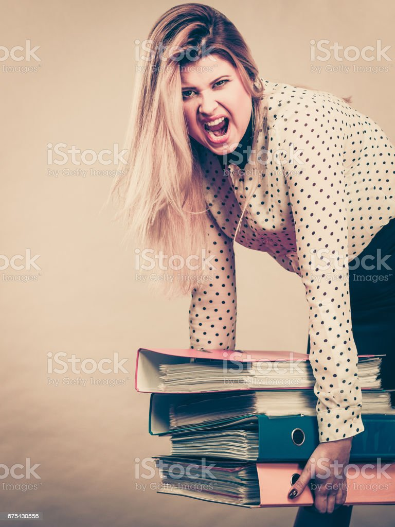 Woman holding heavy colorful binders with documents royalty-free stock photo