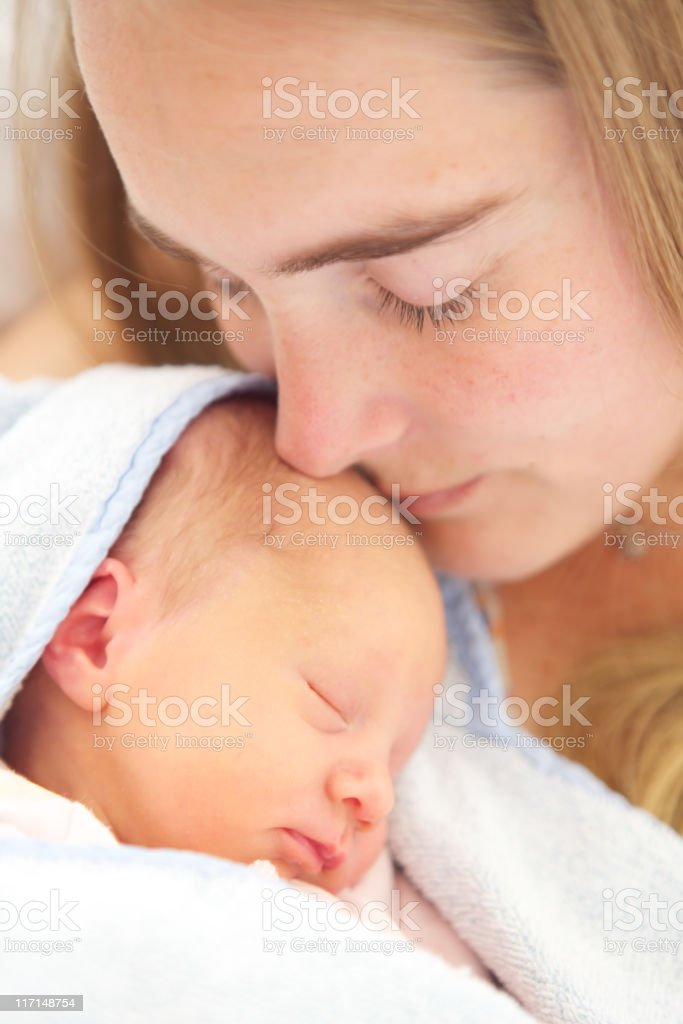 woman holding her 2 days old daughter. XXLarge royalty-free stock photo