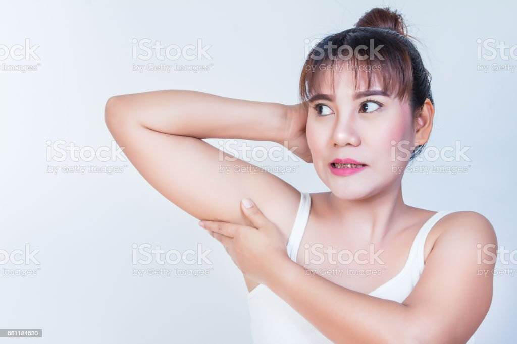 woman holding her arms up and showing underarms stock photo