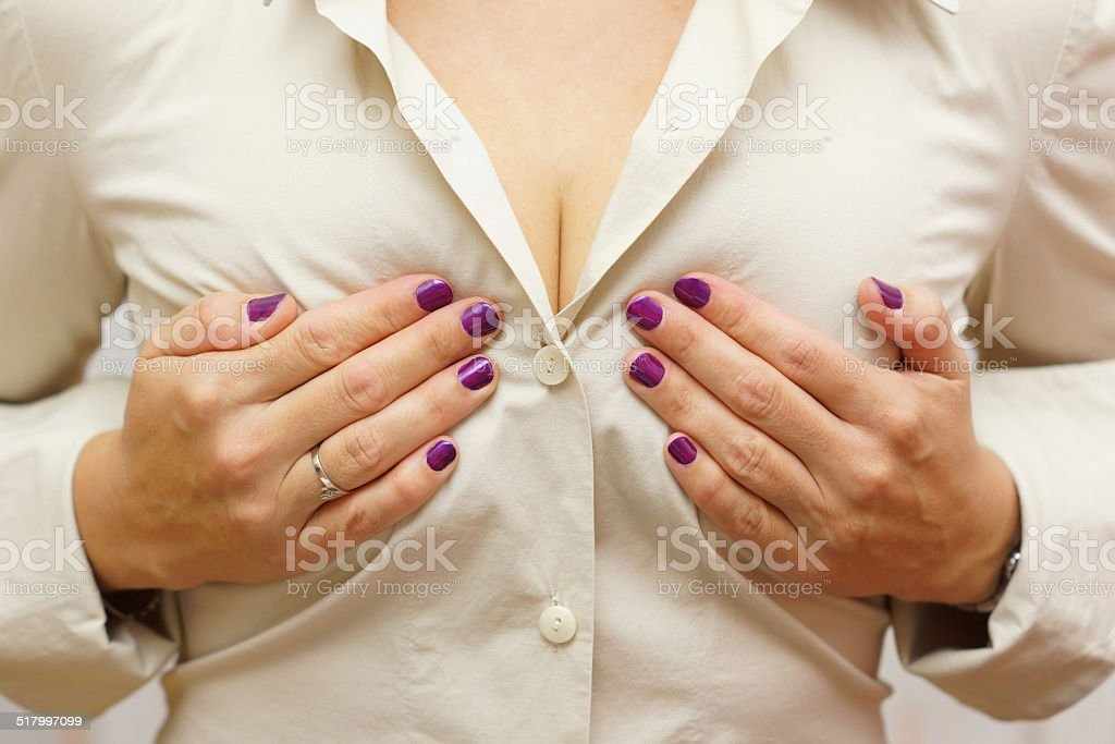 woman holding her breasts stock photo