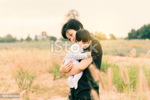 istock Woman holding her daughter for love or relation concept background. 639484504