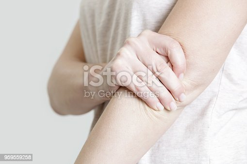istock Woman holding her elbow 959559258