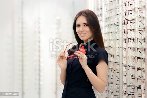 istock Woman Holding Her Glasses in Medical Optical Store 815859448