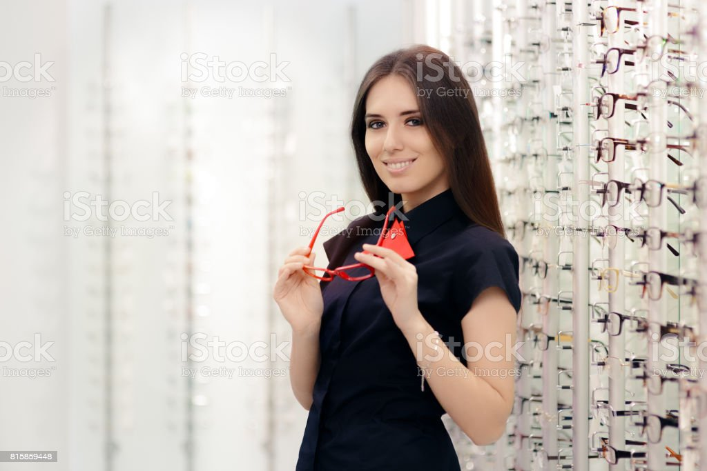 Woman Holding Her Glasses in Medical Optical Store stock photo