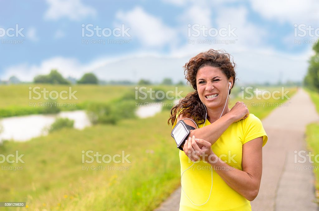 Woman Holding her Injured Elbow stock photo
