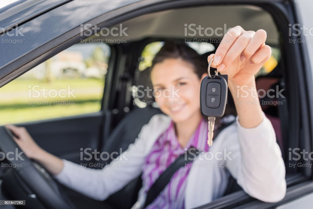 Woman holding her new car keys stock photo