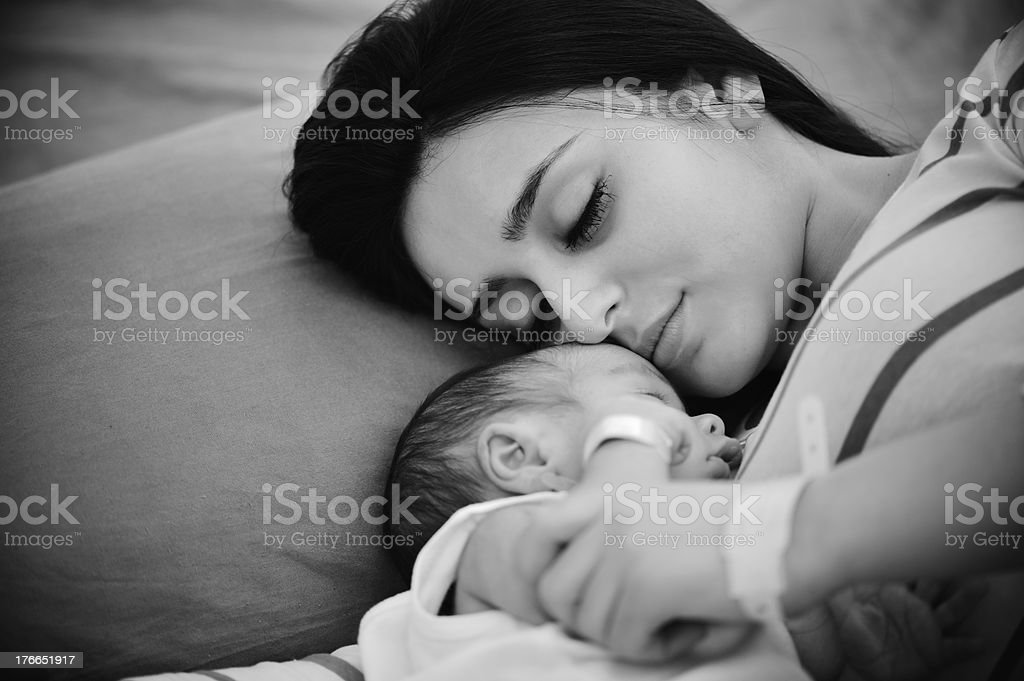 Woman holding her newborn baby at hospital royalty-free stock photo