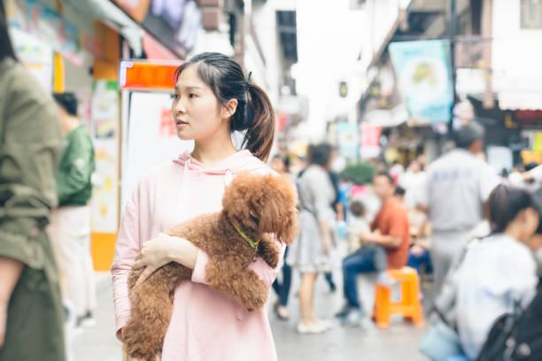 Woman holding her puppy traveling at nanchan temple picture id865585612?b=1&k=6&m=865585612&s=612x612&w=0&h=0dzaxps2bfrio8nyra9mhxzhtnvzv80xi6mbnyngnjg=