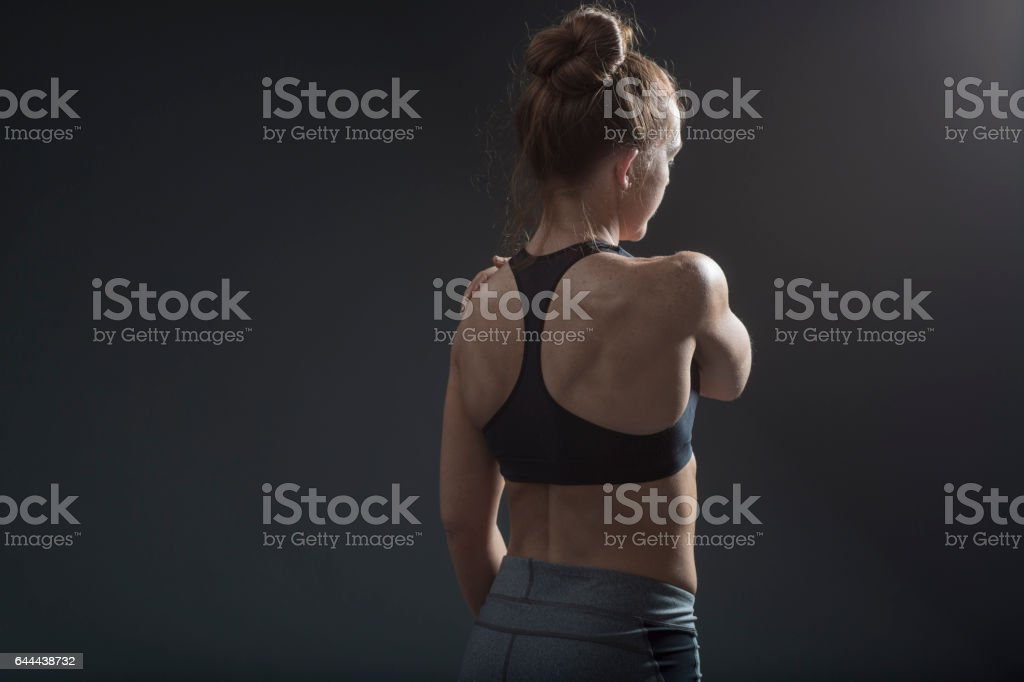 Woman Holding Her Shoulder stock photo