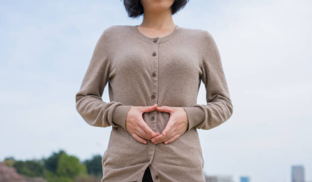 Woman holding her stomach stock photo