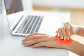 istock Woman holding her wrist pain 1272208320