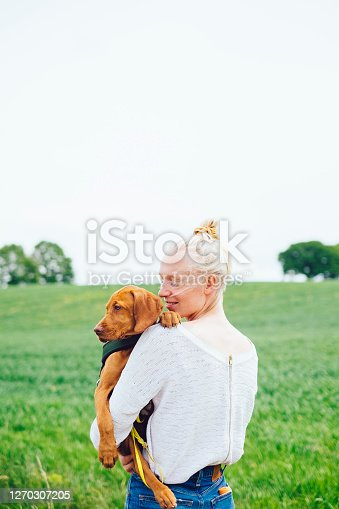 Young Hiking Woman Holding Vizsla Dog, Alt-Lübars, Berlin, Germany