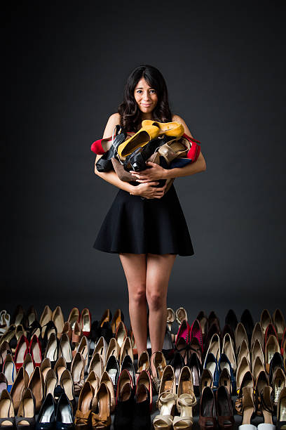 Woman holding high heels stock photo