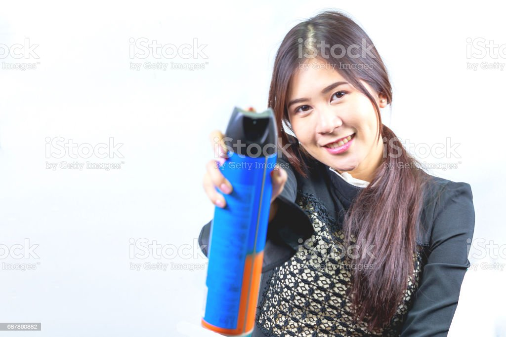 Woman holding insect spray, isolated on white background. stock photo