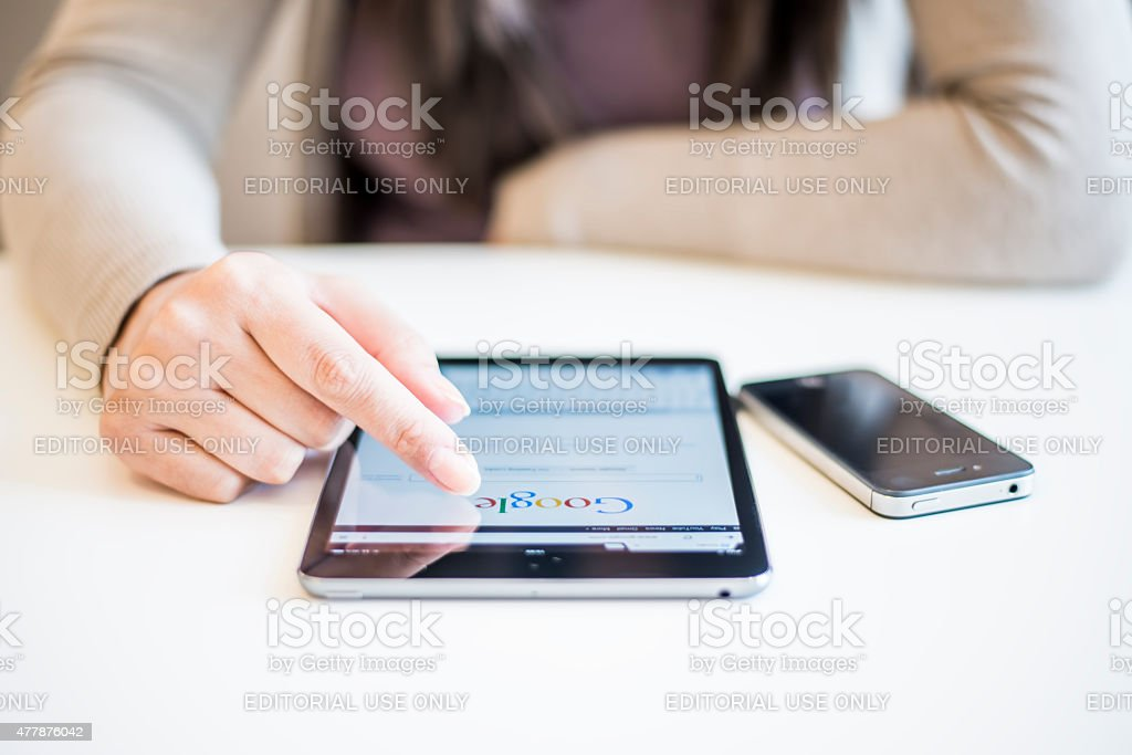 Woman holding Ipad Mini stock photo