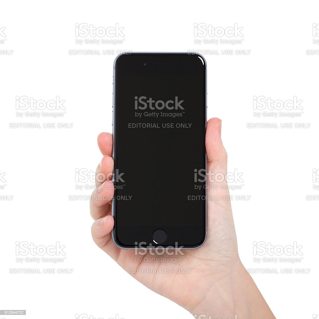 woman holding Isolated new phone iPhone 6 Space Gray stock photo