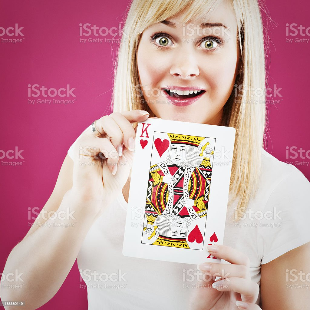 woman holding king of hearts royalty-free stock photo
