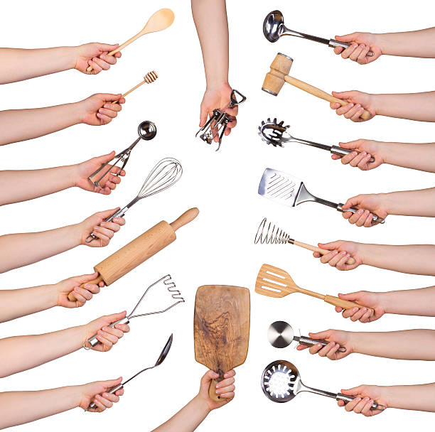 Woman holding kitchen utensils stock photo