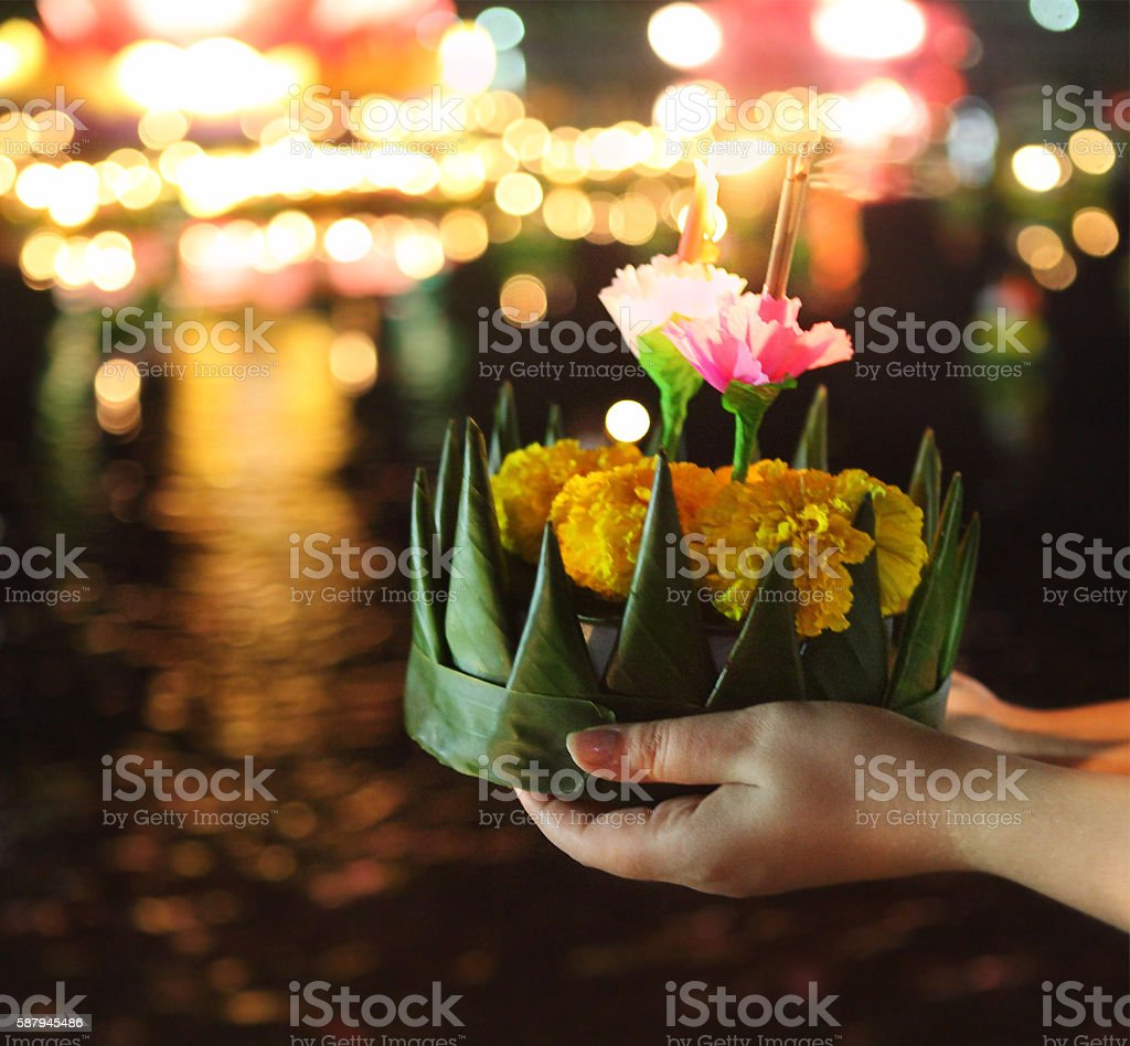 Woman holding kratong in her hands stock photo