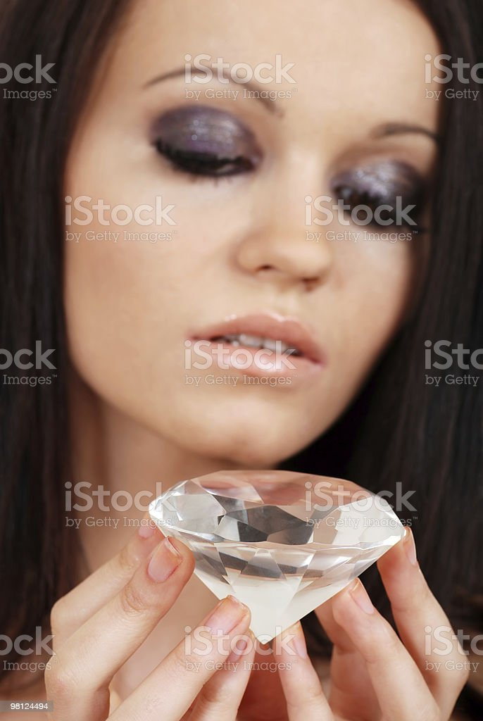 woman holding large diamond focus on stone royalty-free stock photo