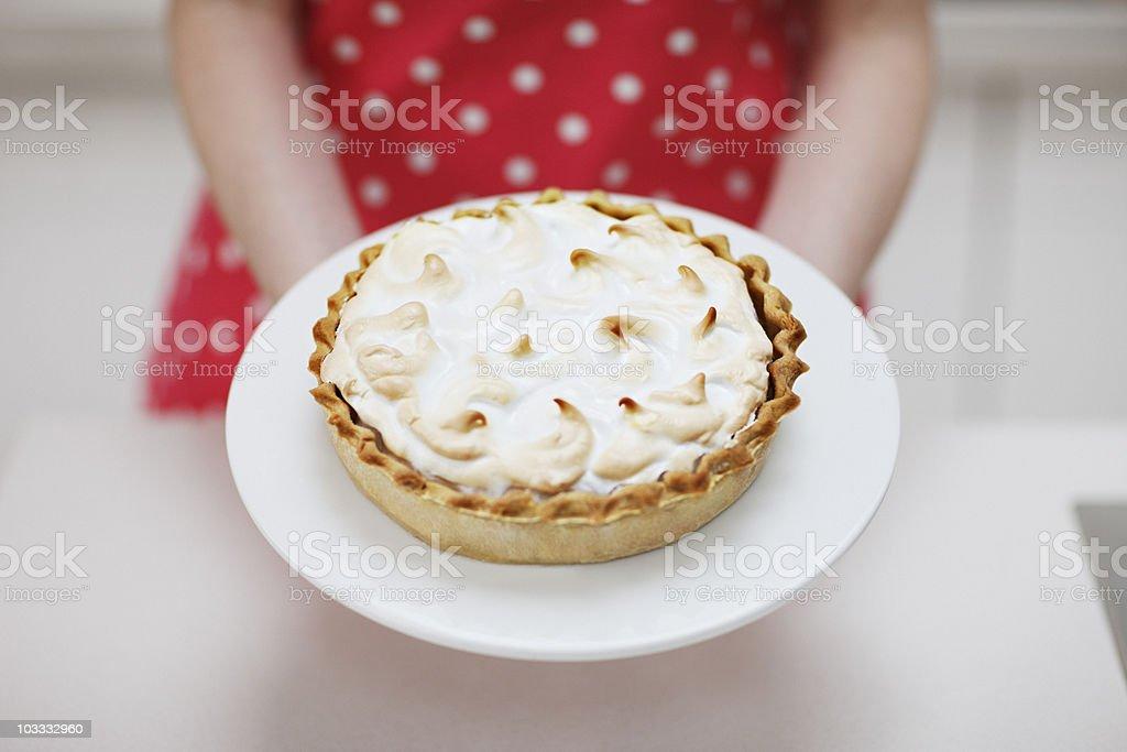 Woman holding lemon meringue pie stock photo