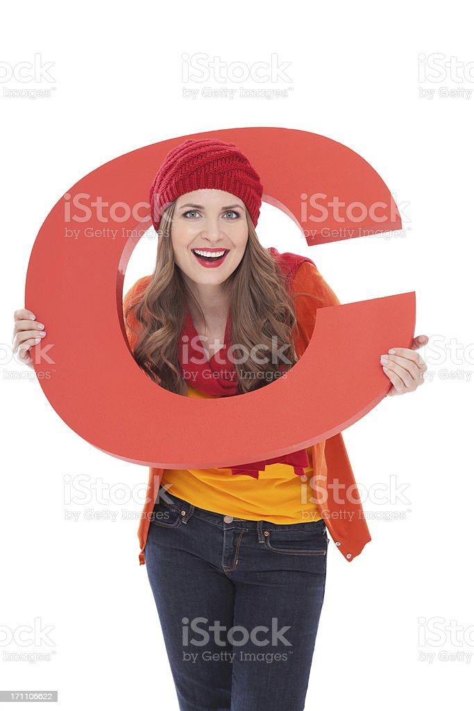 Woman holding letter C. stock photo