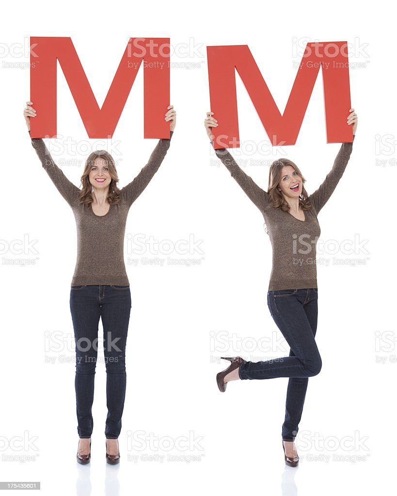 Woman holding letter M. royalty-free stock photo