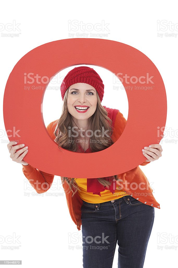 Woman holding letter O. stock photo
