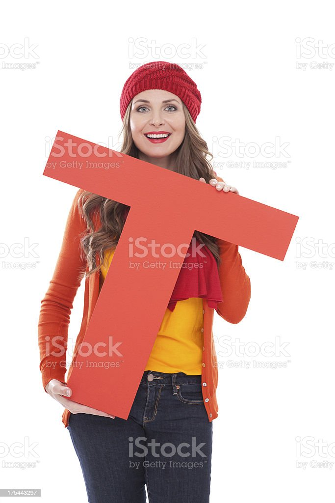 Woman holding letter T. royalty-free stock photo