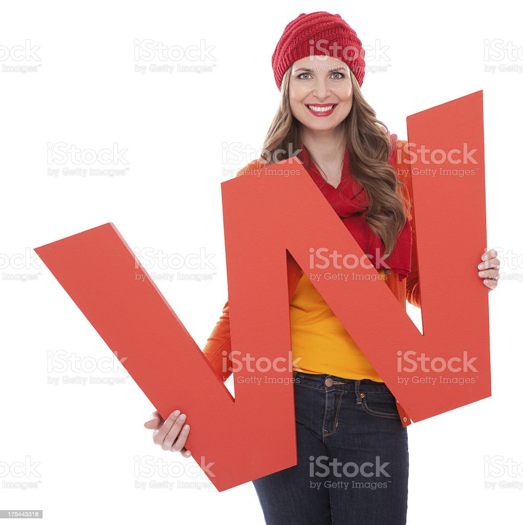 Woman holding letter W. stock photo