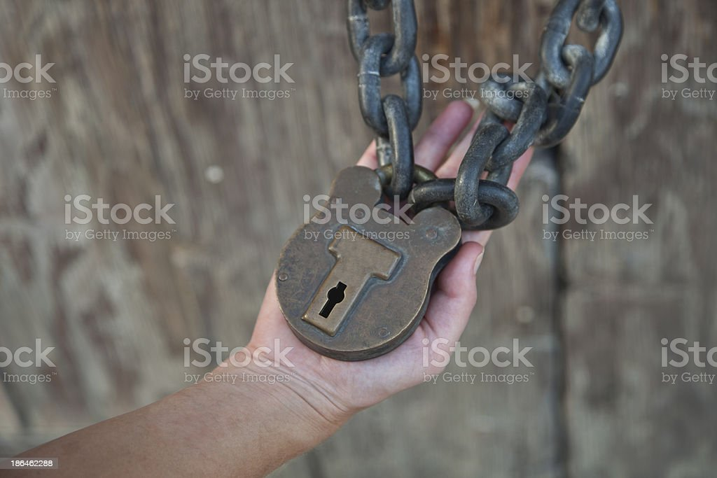Woman Holding Lock and Chain royalty-free stock photo
