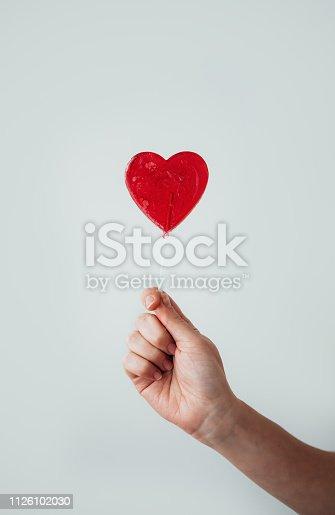Woman holding lollipop