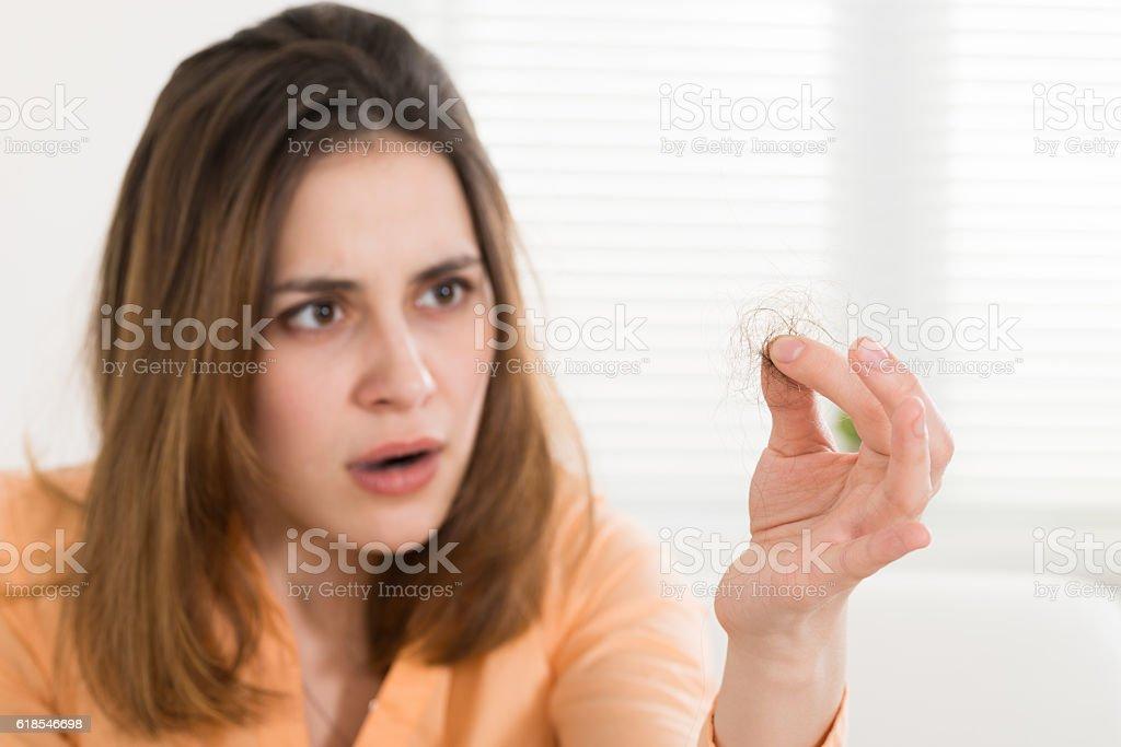 Woman Holding Loss Hair stock photo