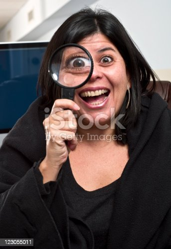 524701060istockphoto Woman Holding Magnifying Glass 123055011