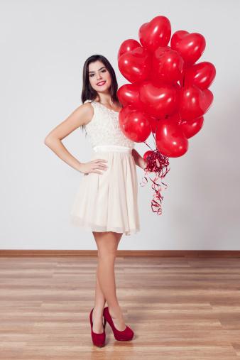 579443552 istock photo Woman holding many balloons in heart-shaped 163218509