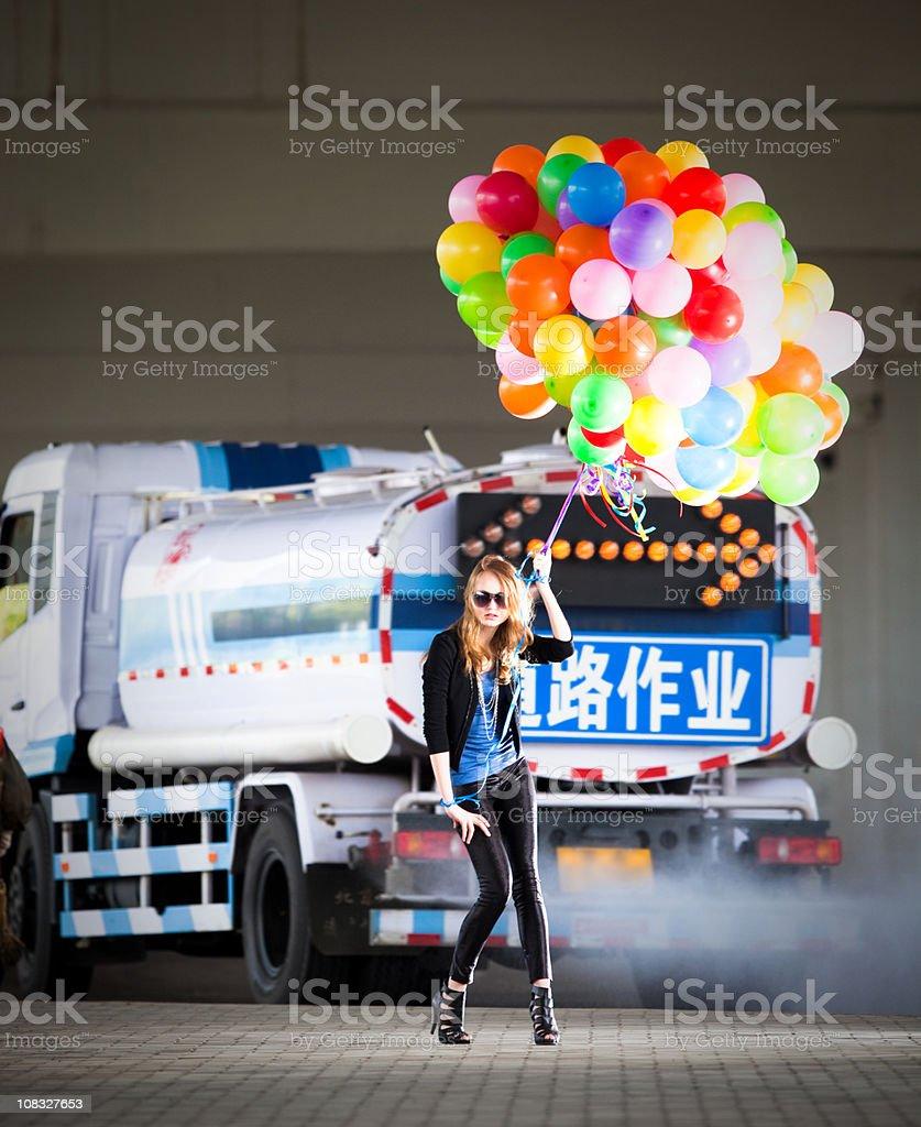 Woman holding many balloons royalty-free stock photo
