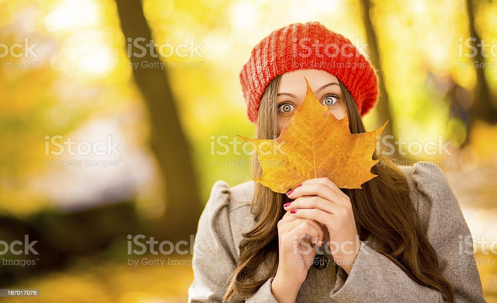 Woman Holding Maple Leaf royalty-free stock photo