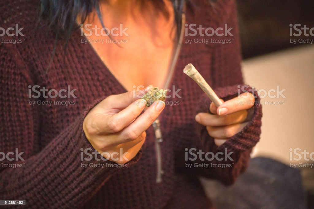 Woman Holding Marijuana Buds and Joint stock photo