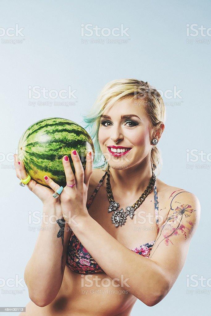 Woman holding melon in bikini stock photo