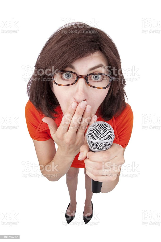 Woman Holding Microphone And Covering Mouth stock photo
