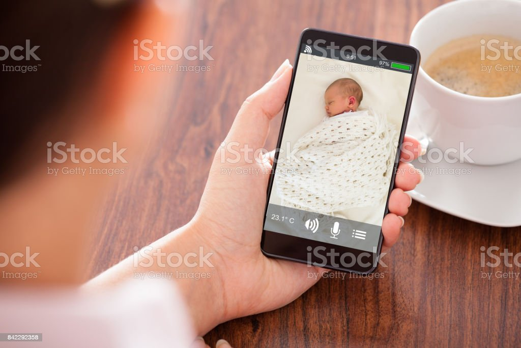 Woman Holding Mobile Phone stock photo