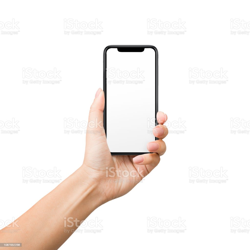 Woman holding mobile phone with blank screen on white background stock photo