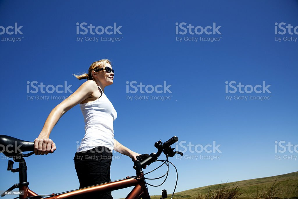 Woman Holding Mountain Bike royalty-free stock photo